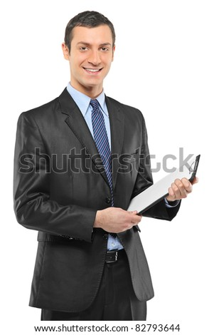 A smiling businessman holding a clipboard isolated on white background - stock photo