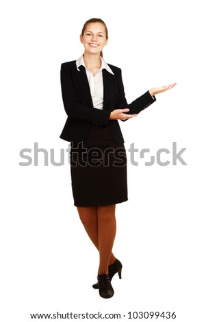 A smiling businesswoman displaying something with her hand, isolated on white background