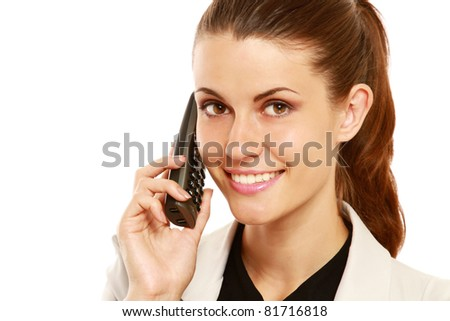 A smiling businesswoman talking on phone, close-up, isolated on white - stock photo