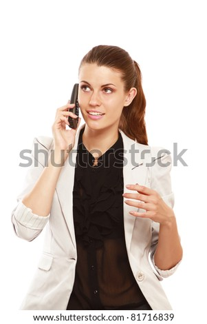 A smiling businesswoman talking on phone, isolated on white - stock photo