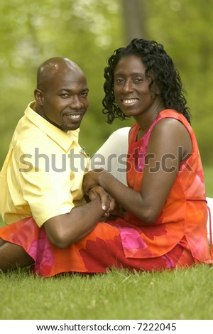 a smiling couple outdoors in Spring