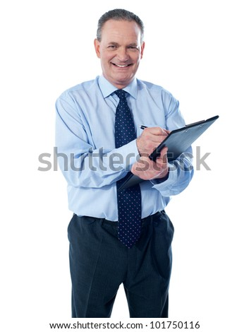 A smiling ethnic businessman writing on a clipboard folder isolated against white background - stock photo
