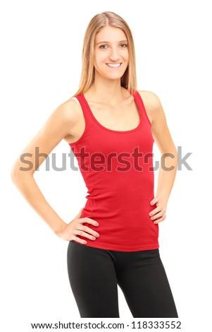 A smiling female athlete posing isolated against white background - stock photo