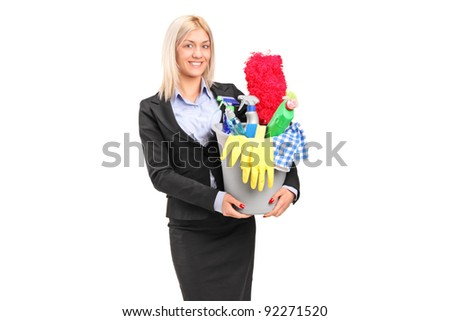 A smiling female holding a bucket full with cleaning supplies isolated on white background - stock photo