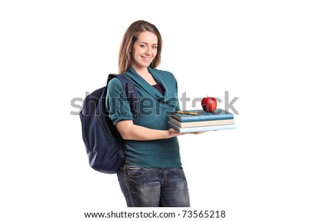 A smiling female student holding books and a red apple isolated on white background - stock photo