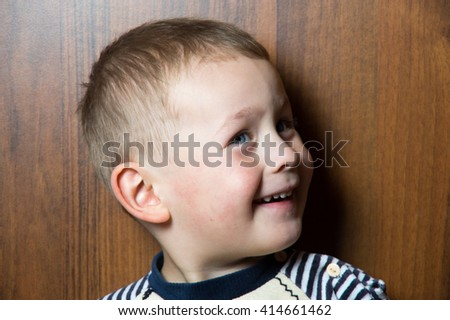 a smiling four years old caucasian boy - stock photo