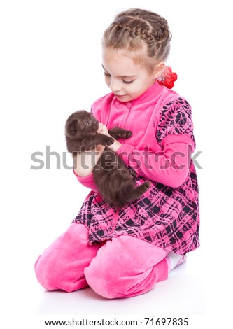 a smiling girl is playing with a kitten. isolated on a white background - stock photo