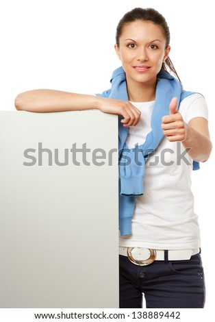 A smiling girl with a blank and showing ok, isolated on white background