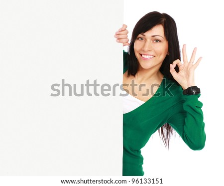 A smiling girl with a blank and showing ok,isolated on white background