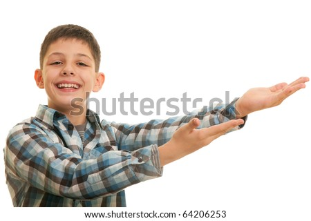 A smiling kid is holding his stretched hands forward; isolated on the white background - stock photo