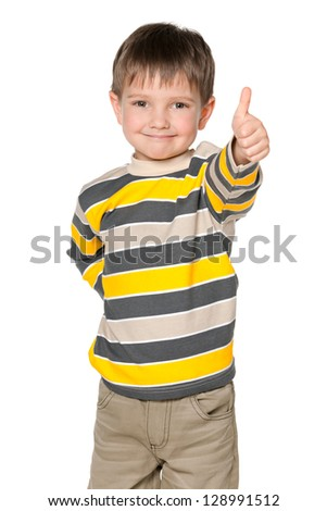 A smiling little boy holding his thumb up on the white background - stock photo