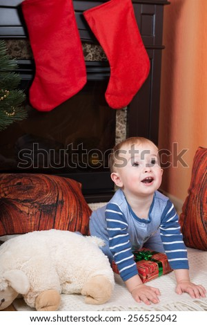 A smiling little boy with a sheep - stock photo