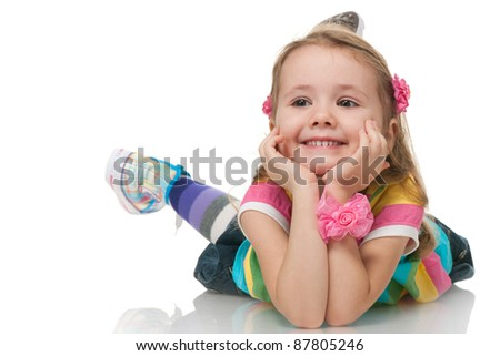 A smiling little girl is looking away; isolated on the white background - stock photo
