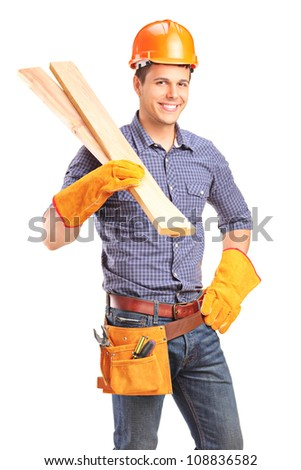 A smiling male carpenter holding sills isolated on white background - stock photo