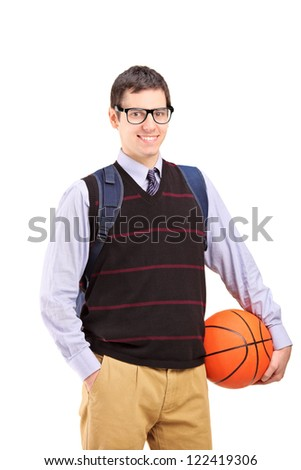 A smiling male student with school bag holding a basketball isolated on white background - stock photo