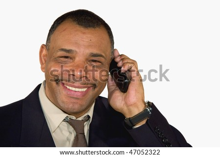 a smiling mature African-American businessman with a cell phone, isolated on white background - stock photo
