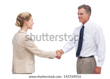 A smiling mature businessman shaking hands with his coworker on white background - stock photo