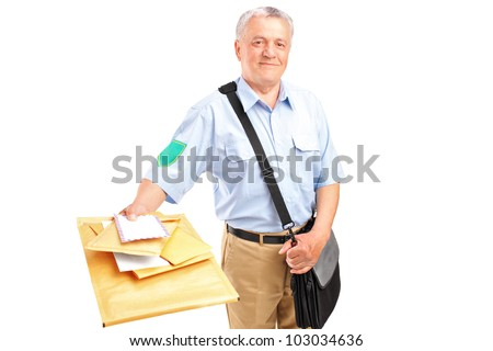 A smiling mature postman delivering letters isolated against white background - stock photo