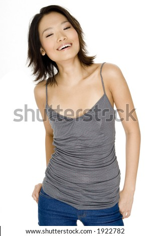 A smiling portrait of a cute young asian woman on white background