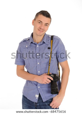A smiling professional male photographer isolated on white background - stock photo