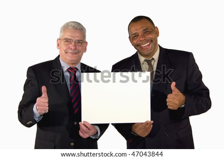 a smiling senior African-American and a caucasian senior businessman presenting a picture board with copy space and posing with thumbs up, isolated on white background - stock photo