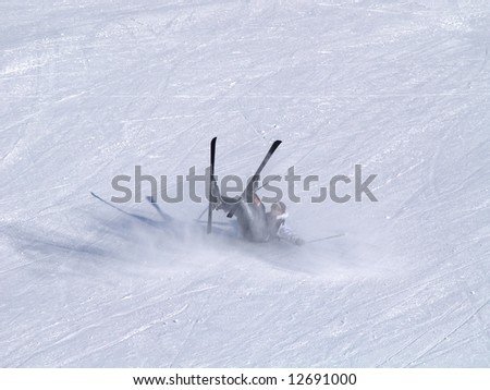 A smiling skier fall on the ski slope. - stock photo
