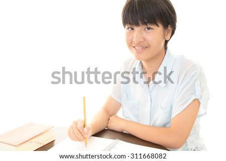 A smiling teen girl - stock photo