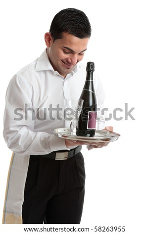 A smiling waiter, bartender, servant or attendant carrying a wine bottle and glasses.  White background. - stock photo