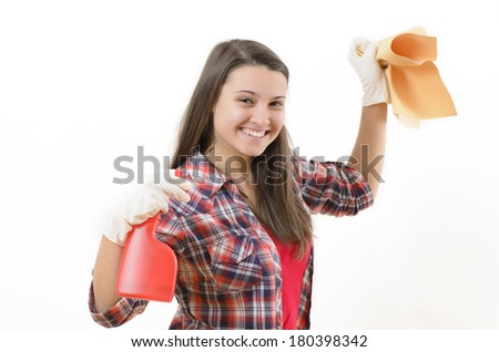 A smiling woman holding some cleaning products - stock photo