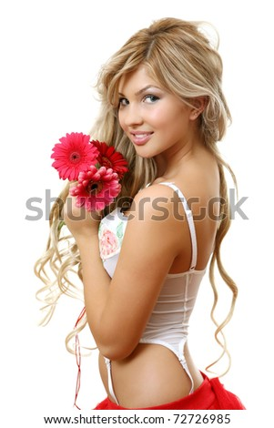 A smiling woman with a bouquet - stock photo
