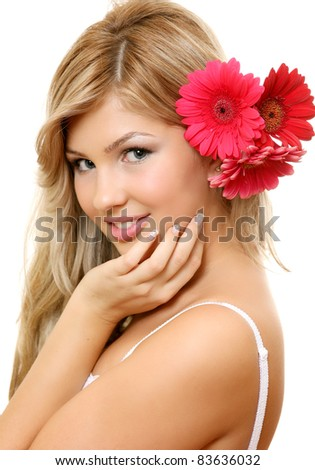 A smiling woman with a flower
