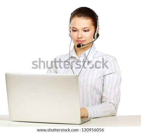 A smiling young customer service girl with a headset at her workplace - stock photo