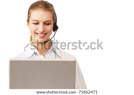 A smiling young customer service girl with a headset at her workplace