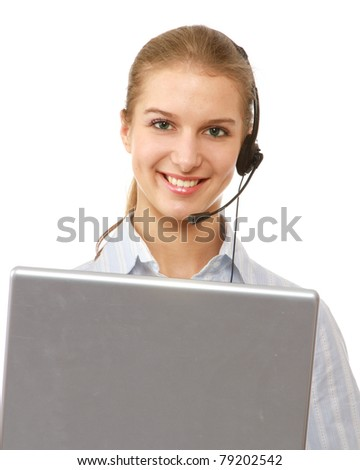 A smiling young customer service girl with a headset at her workplace, isolated on white