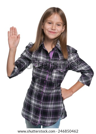 A smiling young girl stretching his right hand up against the white background - stock photo