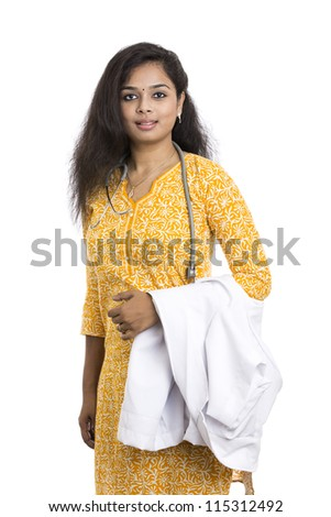 A smiling young Indian Female Doctor on white background. - stock photo
