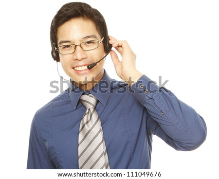 A smiling young man wearing a headset (isolated on white) - stock photo