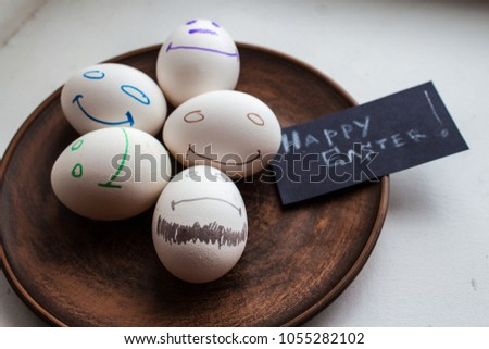A Smilling Easter Eggs In A Plate On White Background