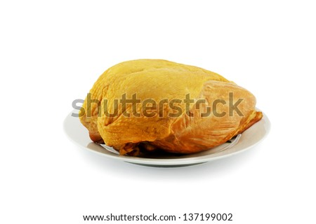 A smoked chicken on plate . Isolated over white. - stock photo