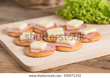 A snack of Crackers with ham, cheese. Selective focus. - stock photo