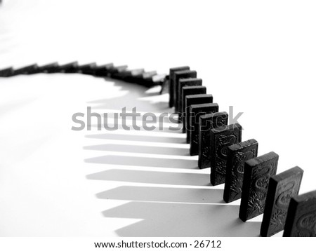 A snake of dominoes falling  - stock photo