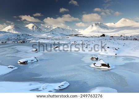 A snow and ice covered winter mountain landscape near Glencoe in the Scottish highlands - stock photo