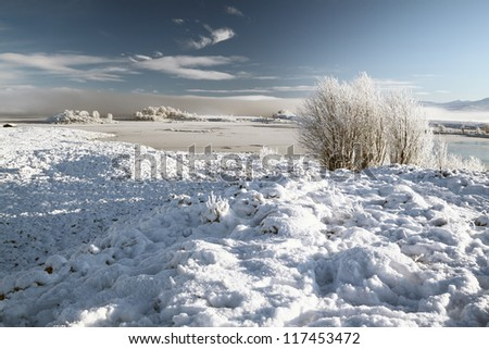 A snow covered  Lochan na stainge winter scene, Rannoch moor, Scotland - stock photo