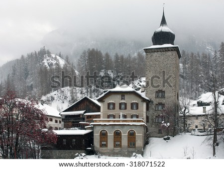 A snow-covered mountain village, in Western Switzerland