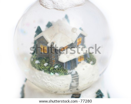 a snow globe with a house inside, wintery spirit - stock photo