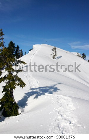 A snow mountain peak during winter snowshoe hiking. - stock photo