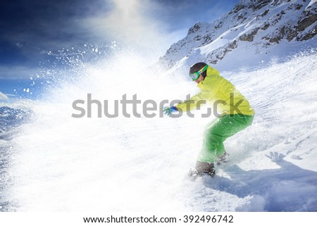 A snowboarder on the piste in Alps in Austria - stock photo