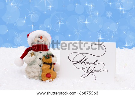 A snowman with a thank you card on a snow background, Winter time - stock photo