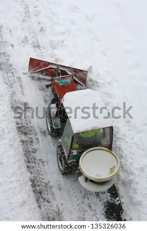A snowplow clearing a road - stock photo