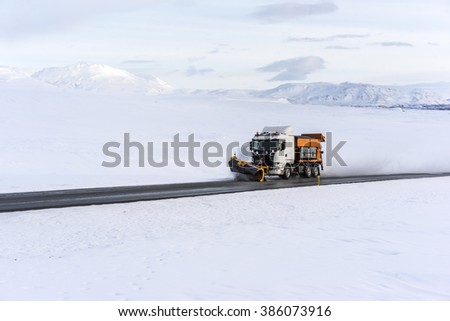 A snowplow clearing Iceland's Ring Road. The snowplows are out clearing the roads very quickly during and after a storm